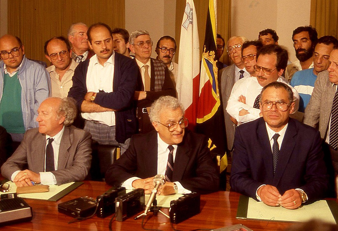 Eddie Fenech Adami addressing a press conference. The author stands behind Ugo Mifsud Bonnici.