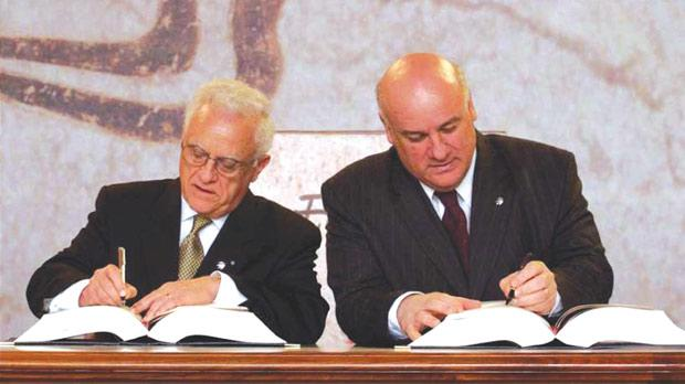 Eddie Fenech Adami signing Malta's EU accession treaty alongside Minister Joe Borg, 2003. Photo Credit: Times of Malta